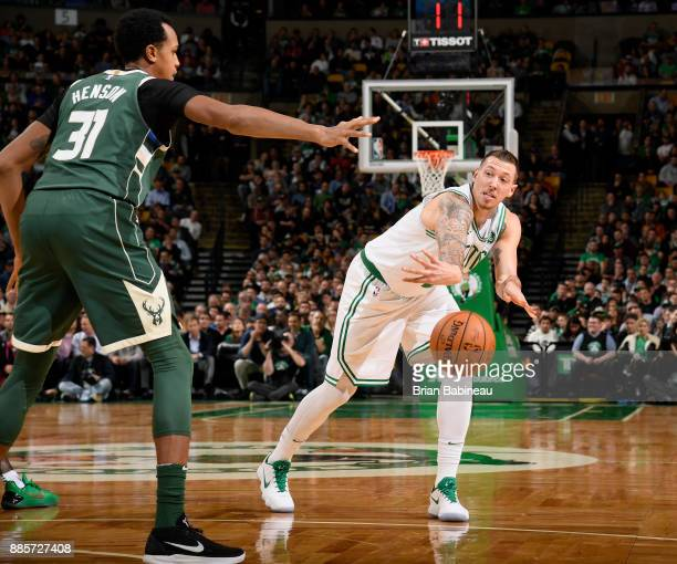 Daniel Theis of the Boston Celtics passes the ball against the Milwaukee Bucks on December 4 2017 at the TD Garden in Boston Massachusetts NOTE TO...