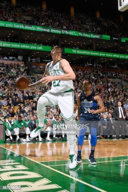 Daniel Theis of the Boston Celtics passes the ball during the game against the Dallas Mavericks on December 6 2017 at the TD Garden in Boston...