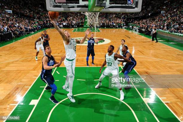 Daniel Theis of the Boston Celtics rebounds the ball during the game against the Dallas Mavericks on December 6 2017 at the TD Garden in Boston...