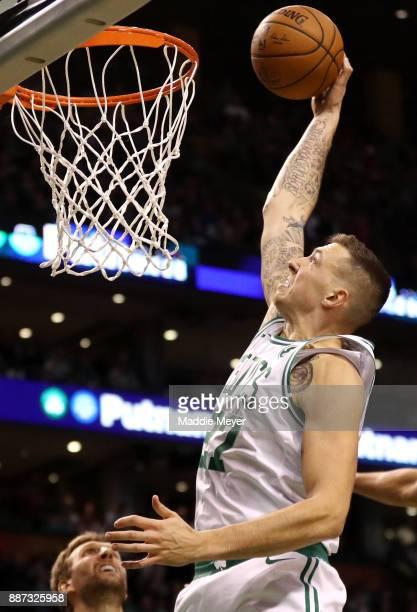 Daniel Theis of the Boston Celtics scores against the Dallas Mavericks during the second half at TD Garden on December 6 2017 in Boston Massachusetts...
