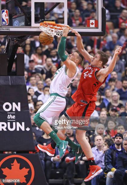 Daniel Theis of the Boston Celtics slams a basket against Jakob Poeltl of the Toronto Raptors in an NBA game at the Air Canada Centre on February 6...