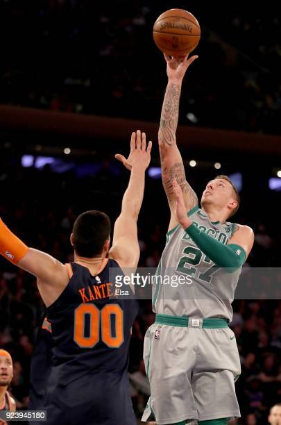 Daniel Theis of the Boston Celtics takes a shot as Enes Kanter of the New York Knicks defends at Madison Square Garden on February 242018 in New York...