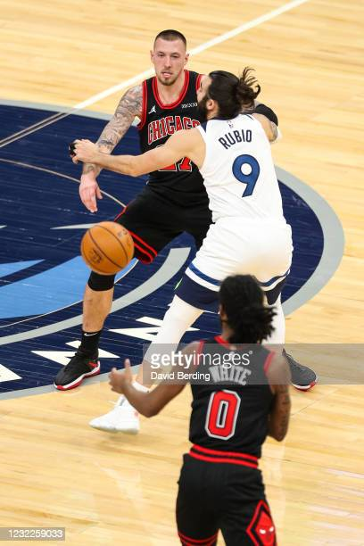Daniel Theis passes the ball to Coby White of the Chicago Bulls while Ricky Rubio of the Minnesota Timberwolves defends in the fourth quarter at...