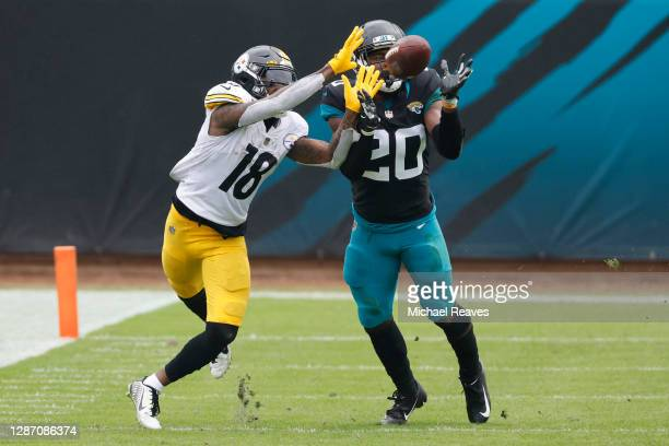 Daniel Thomas of the Jacksonville Jaguars breaks up a pass intended for Diontae Johnson of the Pittsburgh Steelers during the first half at TIAA Bank...