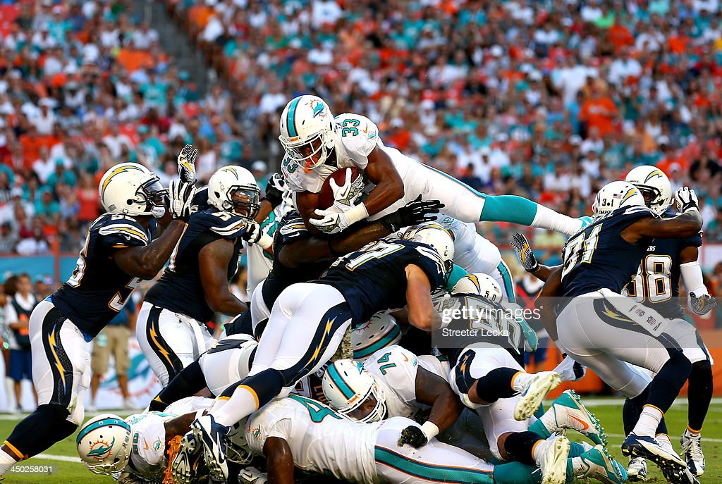 Daniel Thomas #33 of the Miami Dolphins dives for a touchdown during their game against the San Diego Chargers at Sun Life Stadium on November 17, 2013 in Miami Gardens, Florida.