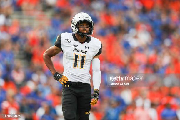 Daniel Thompson IV of the Towson Tigers looks on during the fourth quarter of a game against the Florida Gators at Ben Hill Griffin Stadium on...