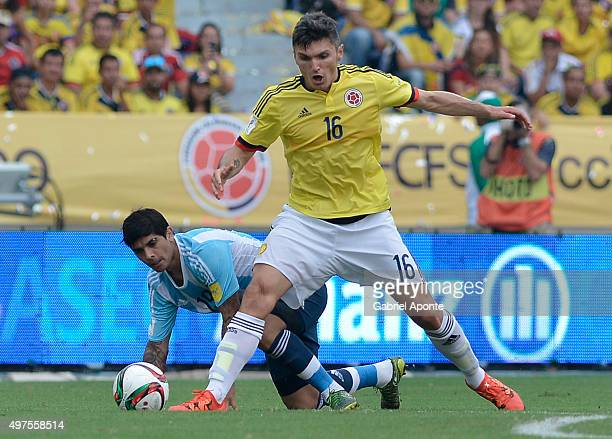 Daniel Torres of Colombia struggles for the ball with Ever Banega of Argentina during a match between Colombia and Argentina as part of FIFA 2018...