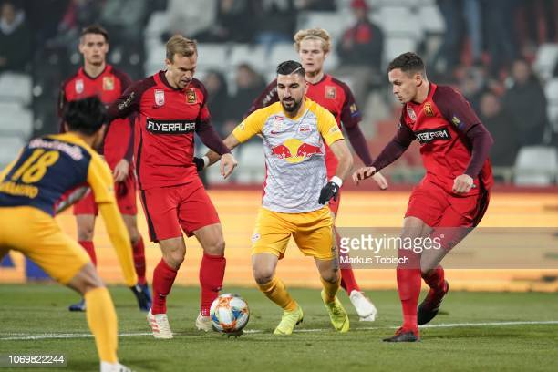 Daniel Toth of Admira Morten Hjulmand of Admira Munas Dabbur of RB Salzburg and Stephan Zwierschitz of Admira during the tipico Bundesliga match...