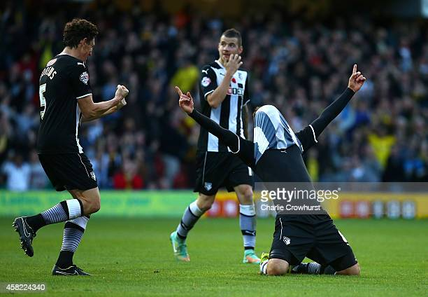 Daniel Tozser of Watford celebrates with team mate Keith Andrews after scoring the teams second goal of the game during the Sky Bet Championship...