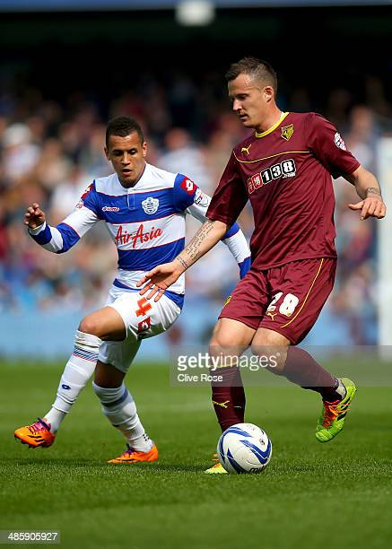 Daniel Tozser of Watford is challenged by Ravel Morrison of Queens Park Rangers during the Sky Bet Championship match between Queens Park Rangers and...