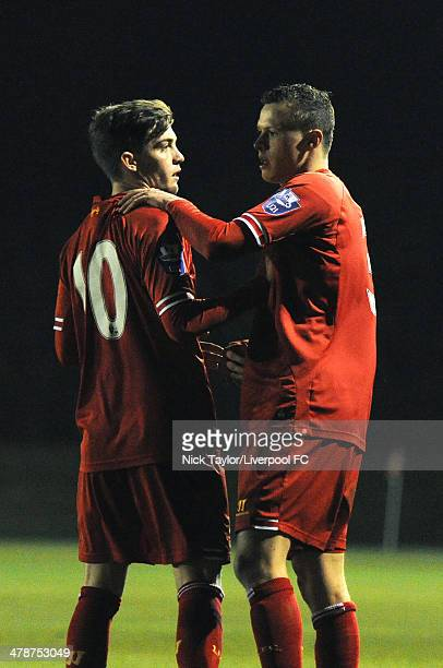 Daniel TrickettSmith and Brad Smith of Liverpool celebrate after a Blackburn own goal levels the scores during the Barclays Premier League Under 21...
