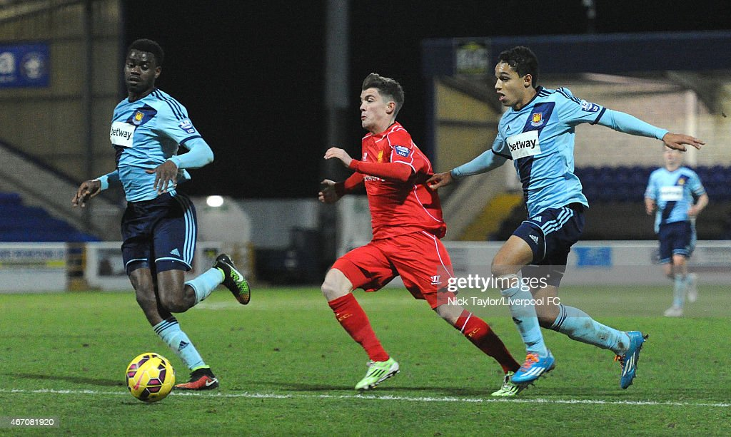 Daniel Trickett-Smith of Liverpool and Emmanuel Onariase and Kyle Knoyle of West Ham United in action during the U21 Premier League game between Liverpool and West Ham United at The Swansway Chester Stadium on March 20, 2015 in Chester, England.