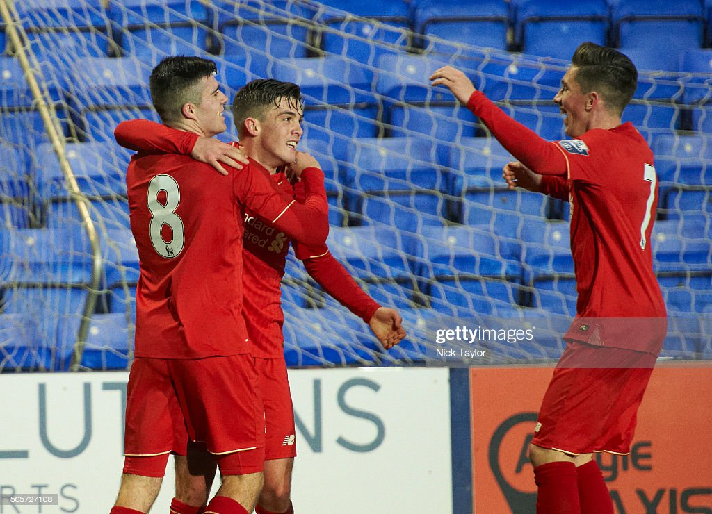 Daniel Trickett-Smith of Liverpool celebrates his goal with team mates Alex O'Hanlon (8) and Harry Wilson (7) during the Liverpool v Leeds United U21 Premier League Cup game at Prenton Park on January 19, 2016 in Birkenhead, England.