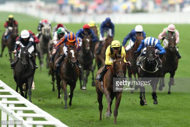 Daniel Tudhope of Addeybb leads the runners and riders on his way to winning The Wolferton Stakes on day one of Royal Ascot at Ascot Racecourse on...