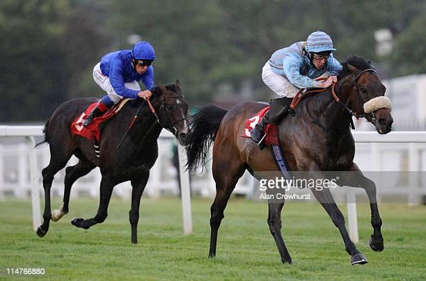 Daniel Tudhope riding Blue Bajan win The Charles Heidsieck Champagne Henry II Stakes at Sandown racecourse on May 26, 2011 in Esher, England.