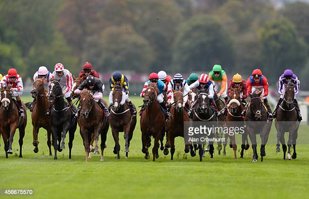 Daniel Tudhope riding Move In Time win The QNB Prix de I'Abbaye de Longchamp at Longchamp racecourse on October 05 2014 in Paris France