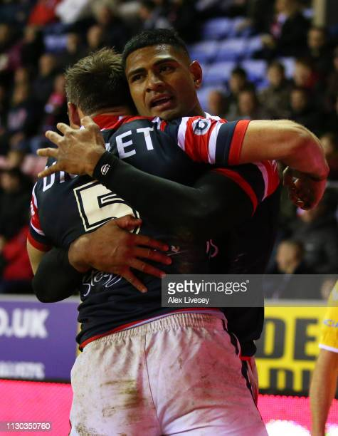 Daniel Tupou of Sydney Roosters celebrates with Brett Morris as he scores their fourth try during the World Club Challenge match between Wigan...