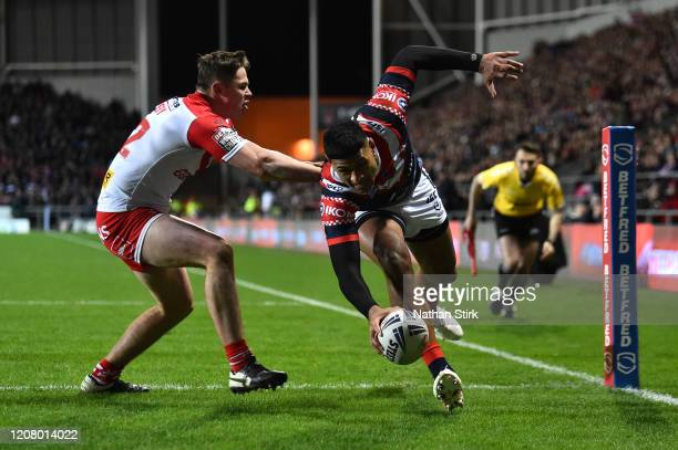 Daniel Tupou of Sydney Roosters scores his sides first try as he is challenged by Jack Welsby of St Helens RFC during the World Club Series Final...