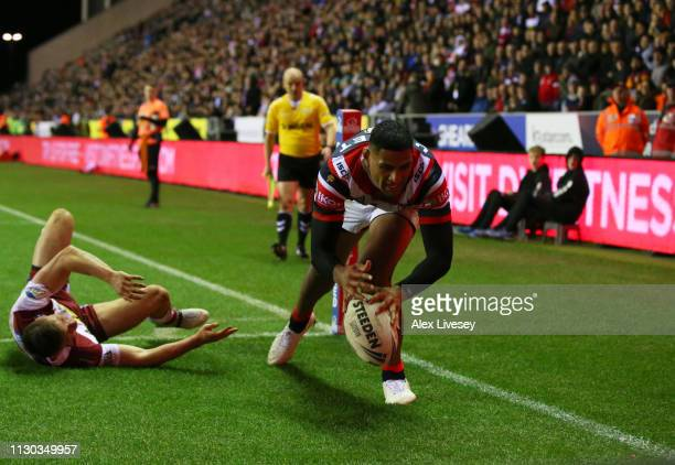 Daniel Tupou of Sydney Roosters touhces down to score their fourth try during the World Club Challenge match between Wigan Warriors and Sydney...