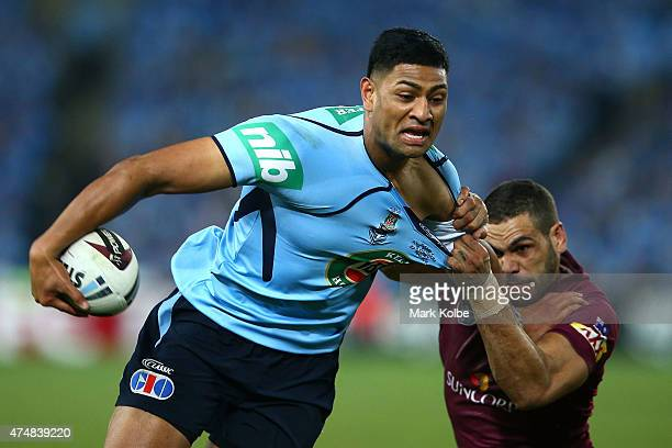 Daniel Tupou of the Blues is tackled by Greg Inglis of the Maroons during game one of the State of Origin series between the New South Wales Blues...