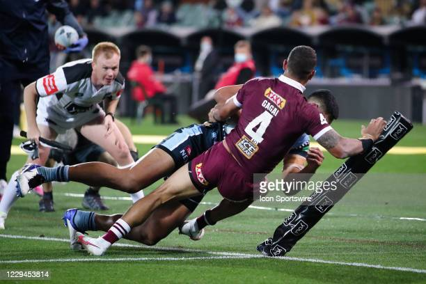Daniel Tupou of the NSW Blues attempts to score a try tackled by Dane Gagai of the QLD Maroons during game one of the 2020 State of Origin series...