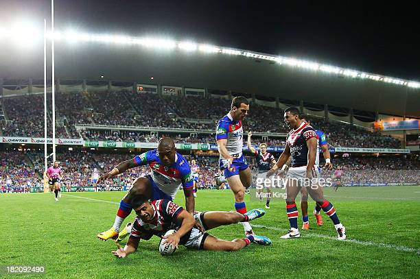 Daniel Tupou of the Roosters beats Akuila Uate of the Knights to score a try during the NRL Preliminary Final match between the Sydney Roosters and...