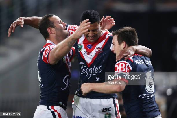 Daniel Tupou of the Roosters celebrates with Boyd Cordner and Luke Keary after scoring the first try during the 2018 NRL Grand Final match between...