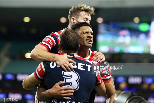 Daniel Tupou of the Roosters celebrates with his team mates after scoring a try during the round five NRL match between the Sydney Roosters and the...