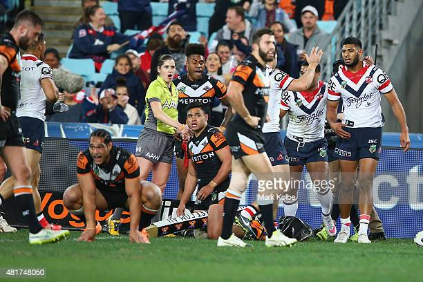 Daniel Tupou of the Roosters celebrates with his team mates after scoring a try during the round 20 NRL match between the Wests Tigers and the Sydney...