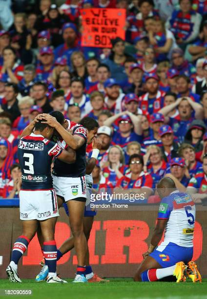 Daniel Tupou of the Roosters celebrates with team mate Michael Jennings after scoring a try during the NRL Preliminary Final match between the Sydney...