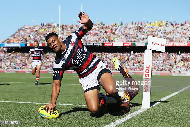Daniel Tupou of the Roosters dives over the try line during the match between Sydney Roosters and the Brisbane Broncos in the Auckland NRL Nines at...