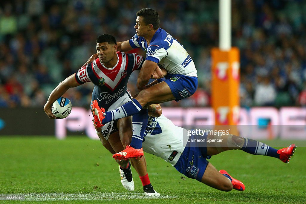 Daniel Tupou of the Roosters is tackled during the First NRL Semi Final match between the Sydney Roosters and the Canterbury Bulldogs at Allianz Stadium on September 18, 2015 in Sydney, Australia.