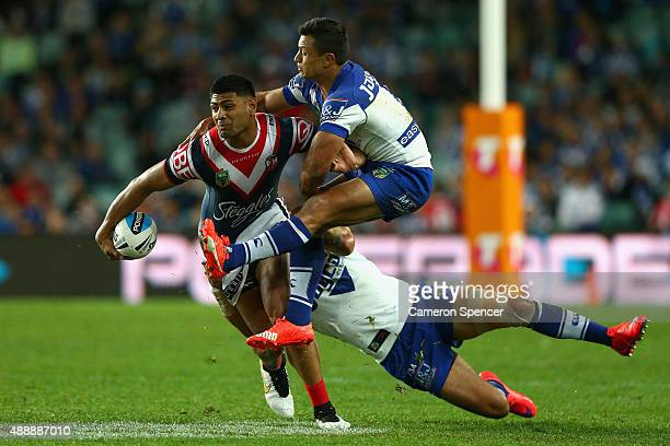 Daniel Tupou of the Roosters is tackled during the First NRL Semi Final match between the Sydney Roosters and the Canterbury Bulldogs at Allianz...