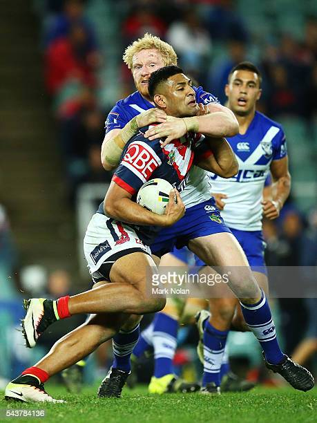 Daniel Tupou of the Roosters is tackled during the round 17 NRL match between the Sydney Roosters and the Canterbury Bulldogs at Allianz Stadium on...