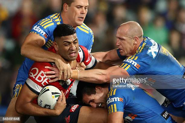 Daniel Tupou of the Roosters is tackled during the round 18 NRL match between the Parramatta Eels and the Sydney Roosters at Pirtek Stadium on July...
