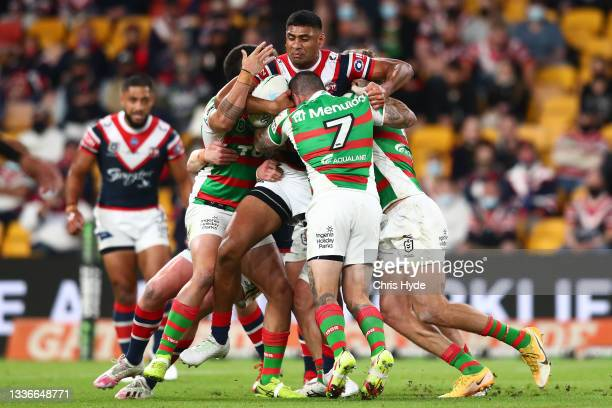 Daniel Tupou of the Roosters is tackled during the round 24 NRL match between the Sydney Roosters and the South Sydney Rabbitohs at Suncorp Stadium...
