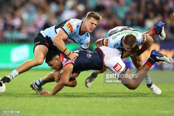 Daniel Tupou of the Roosters is tackled during the round five NRL match between the Sydney Roosters and the Cronulla Sharks at Sydney Cricket Ground,...