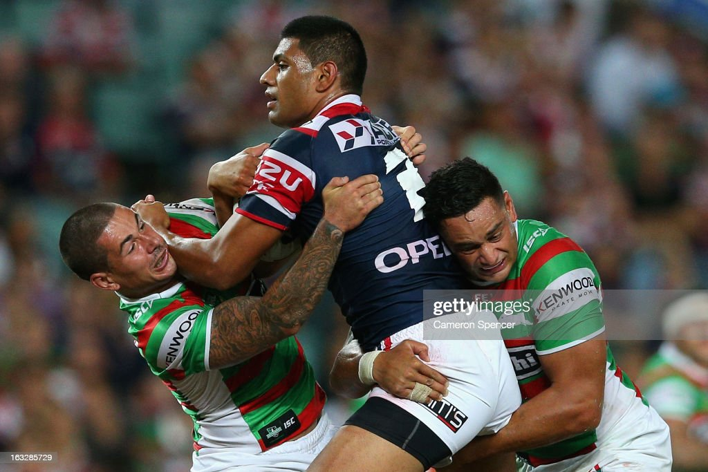 Daniel Tupou of the Roosters is tackled during the round one NRL match between the Sydney Roosters and the South Sydney Rabbitohs at Allianz Stadium on March 7, 2013 in Sydney, Australia.