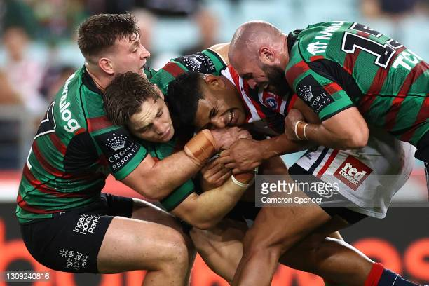 Daniel Tupou of the Roosters is tackled during the round three NRL match between the South Sydney Rabbitohs and the Sydney Roosters at Stadium...