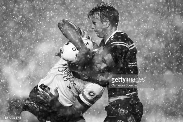 Daniel Tupou of the Roosters is tackled during the round two NRL match between the Manly Sea Eagles and the Sydney Roosters at Lottoland on March 23...