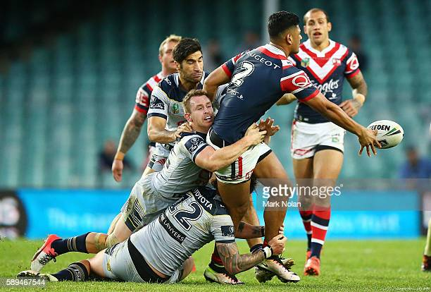 Daniel Tupou of the Roosters offloads during the round 23 NRL match between the Sydney Roosters and the North Queensland Cowboys at Allianz Stadium...