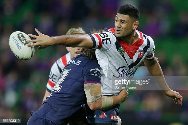Daniel Tupou of the Roosters passes the ball during the round 20 NRL match between the Melbourne Storm and the Sydney Roosters at AAMI Park on July...