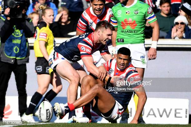 Daniel Tupou of the Roosters scores a try during the round 21 NRL match between the Canberra Raiders and the Sydney Roosters at GIO Stadium on August...