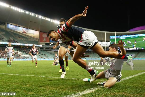 Daniel Tupou of the Roosters scores a try during the round 21 NRL match between the Sydney Roosters and the North Queensland Cowboys at Allianz...