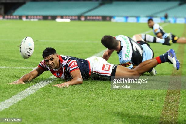 Daniel Tupou of the Roosters scores a try during the round five NRL match between the Sydney Roosters and the Cronulla Sharks at Sydney Cricket...