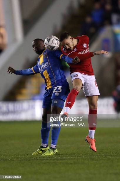 Daniel Udoh of Shrewsbury Town and Josh Brownhill of Bristol City during the FA Cup Third Round Replay match between Shrewsbury Town and Bristol City...