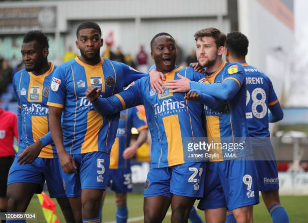 Daniel Udoh of Shrewsbury Town celebrates with his team mates after scoring a goal to make it 1-0 during the Sky Bet League One match between...