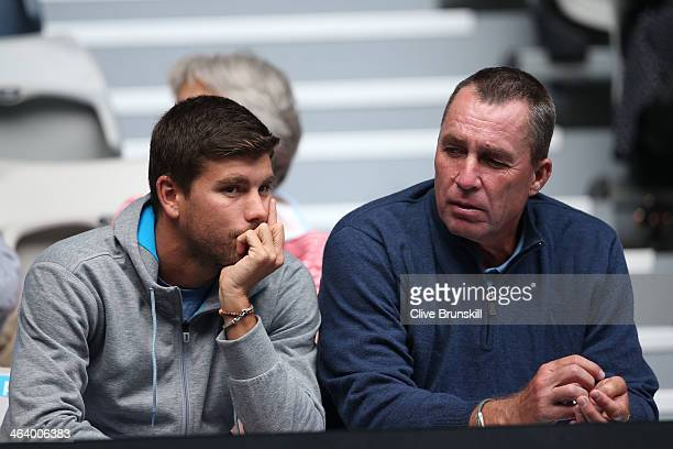 Daniel Vallverdu and Coach of Andy Murray Ivan Lendl watches him in his fourth round match against Stephane Robert of France during day eight of the...
