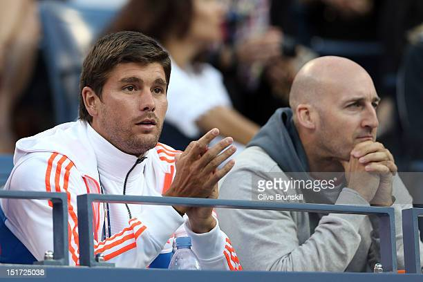 Daniel Vallverdu and Jez Green watch Andy Murray of Great Britain during his men's singles final match against Novak Djokovic of Serbia on Day...