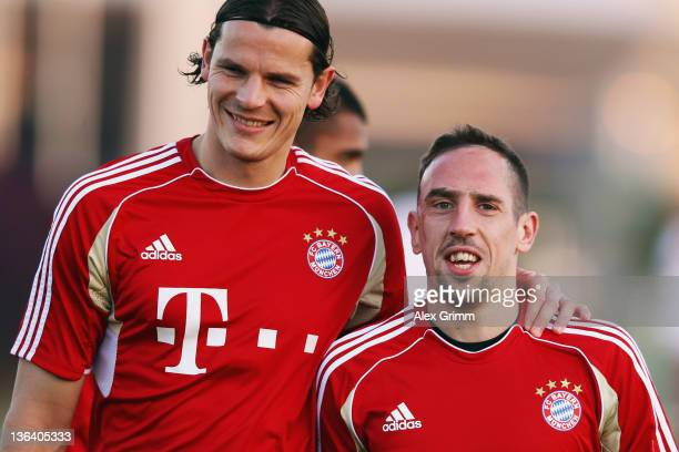Daniel van Buyten and Franck Ribery reacts during a training session of Bayern Muenchen at the ASPIRE Academy for Sports Excellence on January 4 2012...